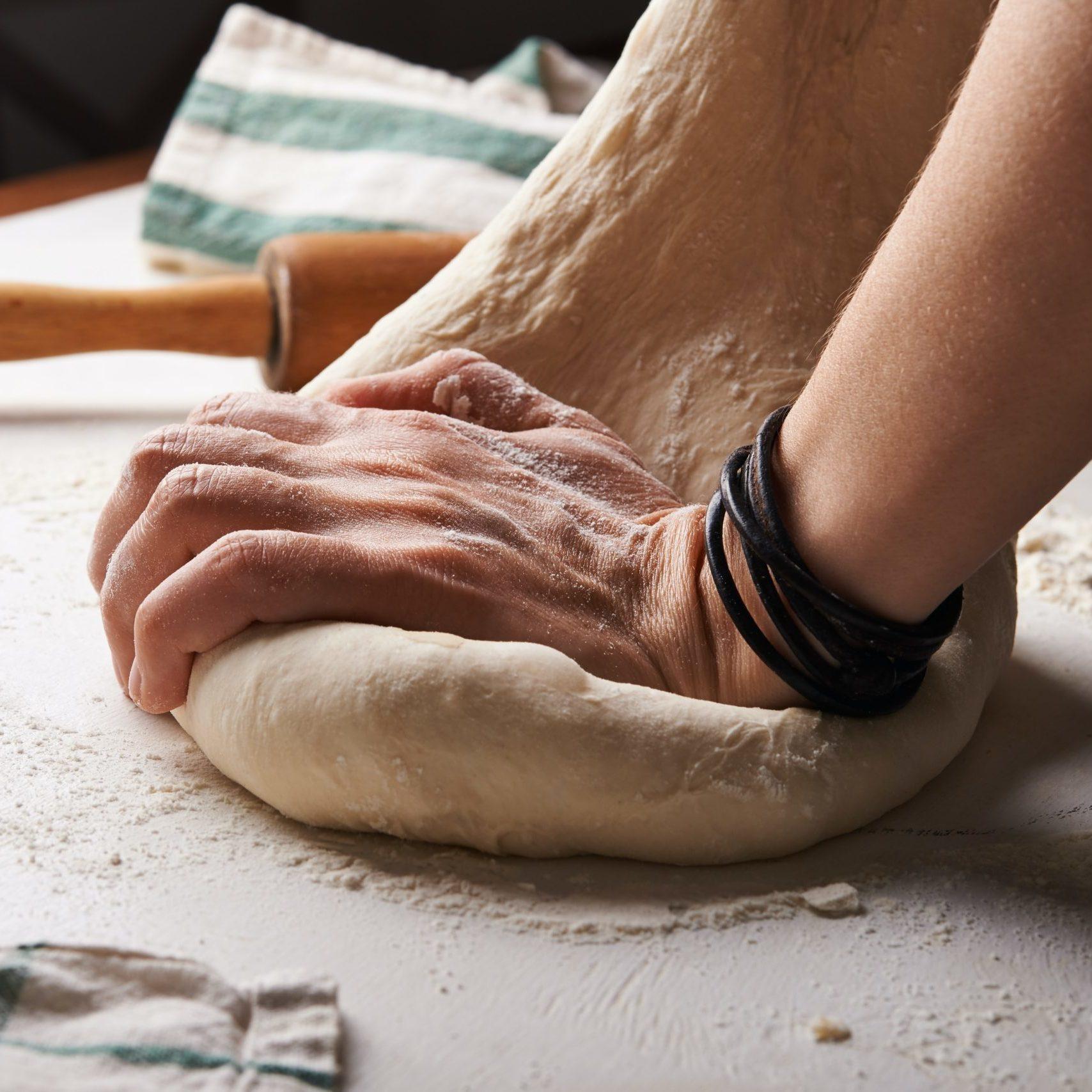Hand kneading bread