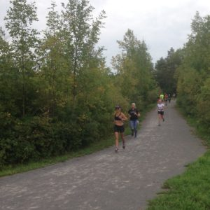 Three runners on a path