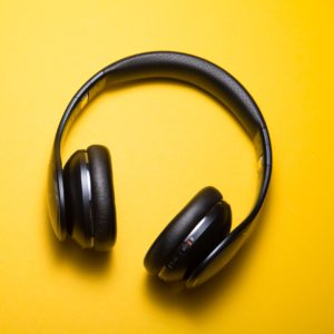 Black headphones on yellow background