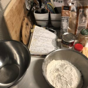 Baking ingredients and bowl of flour