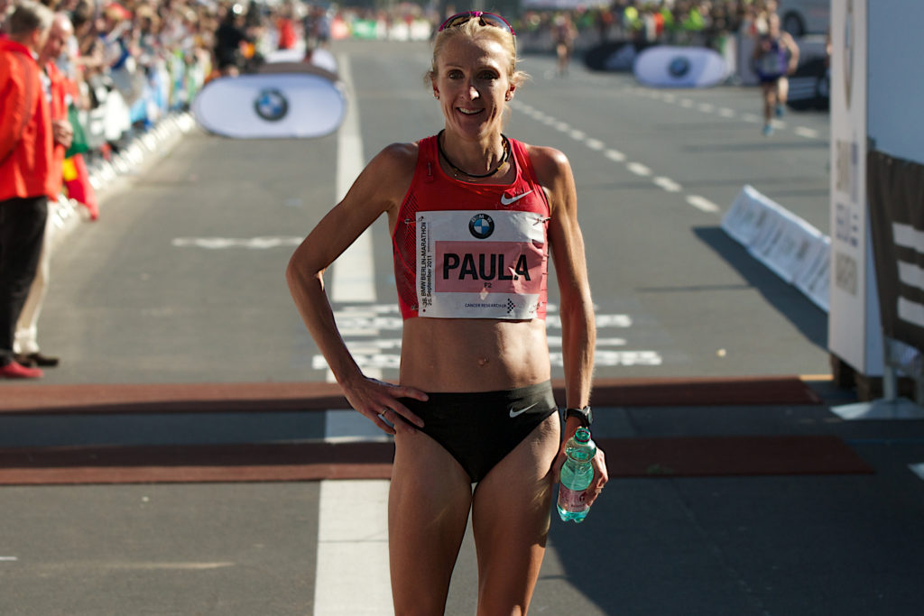 Athletic person smiling at the end of a race