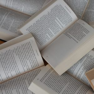 Several open books in a pile