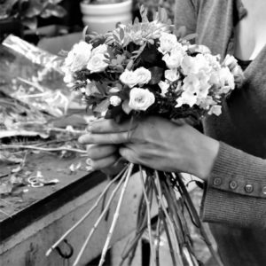 Person arranging flowers