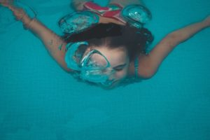person under the surface of a swimming pool