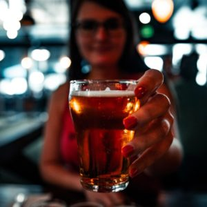 Hand holding a glass of beer